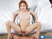 Shaved redhead with a nice rack helps a POV cock reach ecstasy in bed