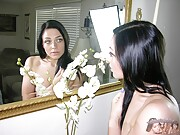 Adorable Dark Haired Woman Modeling Nude And Giving A Handjob