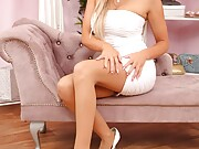 Busty blonde peels off her tight minidress and poses in a g-string