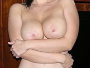 Dark Haired Amateur Beauty Showing Off Her Big And All Natural Breasts