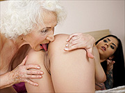 Granny and the younger woman licking
