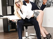 Skinny blonde chick fucks her hung black co-worker in the office