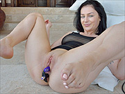 Raven hair chick with toys in both her holes