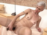 Skinny mature lady in stockings Espoir aka Belinda Bee playing with her pussy