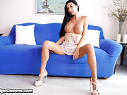 Tanned babe with fake boobs jerks a cock with a Fleshlight