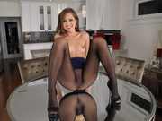 Riley Reid teases with her pantyhosed pussy wearing no undies under her attire