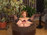 Redheaded mom Veronica Bella slowly strips for wet toy play in her black holdups