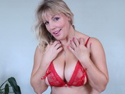 Danielle Mannaken strips and plays with her giant boobs in red lingerie