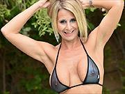Busty blonde bikini milf in backyard