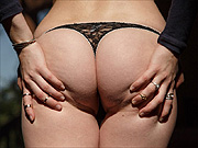 Arousing freckled face coed thong pantie teasing
