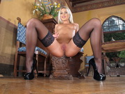 Czech blonde in stockings Lola Myluv uses a glass dildo to pleasure her wet twat