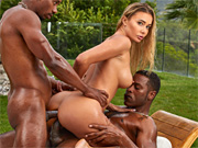Babe gets double penetrated by massive black shafts