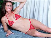 Fit milf Sofie Marie strips tiny mesh bikini