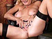 Busty Molly Maracas in nylons spreading her cunt