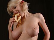 Big boobs pigtails blonde munching on bananas