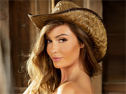 Sexy cowgirl exposes her perfect curves in the barn