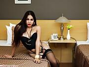 Vitress asian ladyboy in black stockings and heels