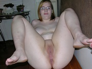 Amateur Glasses Wearing Girl Showing Her Big Tits And Shaved Pussy