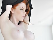 Beauty redhead Fi Stevens shows off her sexy tits