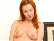 Amateur redhead on the bed touching herself
