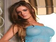 American brunette model Holly Weber posing outdoors in blue see through lingerie