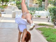 Ex cheerleader does pussy revealing cartwheels on sidewalk