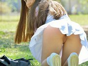 Darling teen Latina upskrit pussy peeks at public park