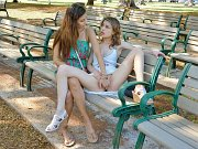 Lesbian darlings fingerbang on a public park bench