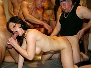 German brunette whore Rumina Royal enjoying wild amateur gangbang orgy