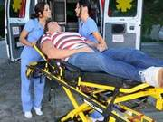 Two brunettes with amazing ass serve male patient inside ambulance van.