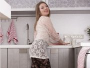 Hairy Amber plays with flour in the kitchen playfully