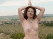 Hairy amateur Elena strips and does naked yoga outdoors