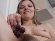 Mature Aga enjoys grapes and strips naked on table