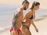 Aussie Rugby Player Quade Cooper in his red speedos.