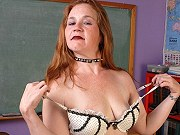 Fat redheaded mature teacher Spicy gets naked and spreads in classroom
