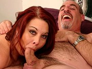 Fat mature redhead Nina giving a blowjob and getting fucked on the bed