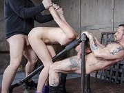 Zoey Laine is locked in metal pipes and double fucked by maledoms