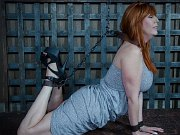 Lauren Phillips busty redhead is stripped and chained in dungeon