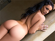 Stunner strips out of her bodysuit in front of the mansion