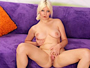 sexy blonde woman gets naked and open her smooth and shaved pussy