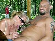 Blonde german mature Lady Vivia giving head and riding a cock outdoors