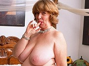Bigtits mature fattie Margerie getting naked and showing her big pussy