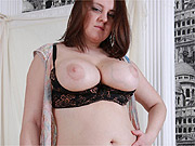 Chubby gal slowly strips revealing tits and ass