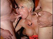 a blonde wife milf having fun in a bukkake facials party