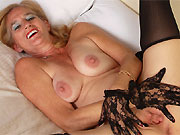Ray Lynn mature blonde poses in black gloves and stockings