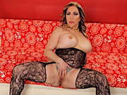 Sexy MILF gets naked and open her legs wide to show off her shaved pussy