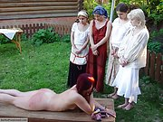 Three Russian slaves stripped naked and punished by public spanking outdoors