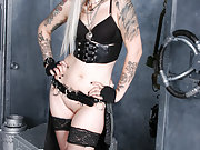 Tattooed Industrial Beauty in Boots and Leather