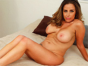 Busty Latina milf strips in the bedroom