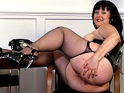 Brunette fat mature Wendy in black stocking spreading her shaved pussy
